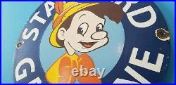 Vintage Standard Gasoline Porcelain Gas Pinocchio Walt Disney Service Pump Sign